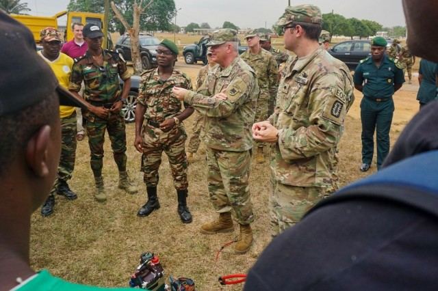 Brig. Gen. Kenneth Moore, U.S. Army Africa deputy commanding general and Army Reserve Engagement Cell chief, speaks with Cameroonian engineers during a visit to see U.S. Army Explosive Ordnance Disposal Technicians from the 723rd Ordnance Company (EOD) in Fort Campbell, Kentucky, conduct a train-the-trainer engagement for counter-improvised explosive device (C-IED) training in Douala, Cameroon, Feb. 7, 2017. The U.S. Army Africa-led engagement brought subject matter experts to share their best practices with Cameroonian engineers to increase their capacity to conduct C-IED missions.