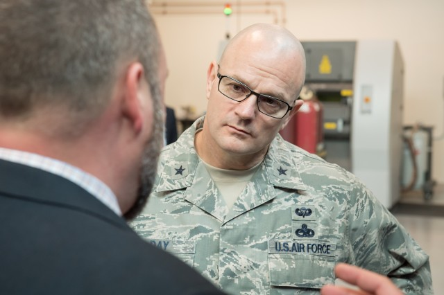 Brig. Gen. Allan E. Day (right), commander of Defense Logistics Agency Aviation, visits with additive manufacturing engineers at the U.S. Army Research Laboratory at Aberdeen Proving Ground, Maryland, Feb. 23, 2017.
