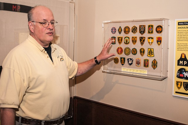 Jim Rogers, U.S. Army Military Police School Museum director, talks about the collection of MP patches and insignia on display in the museum.