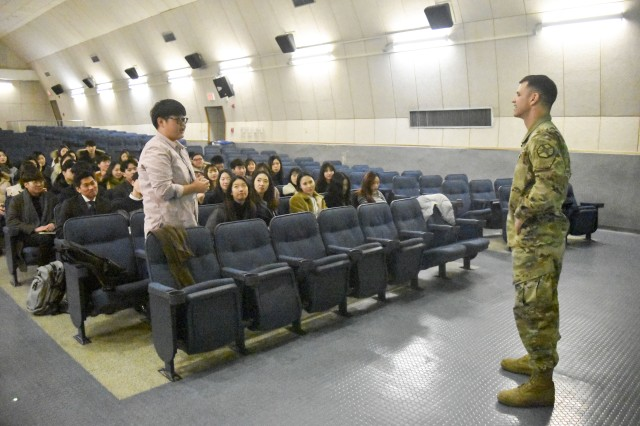 United States Army Garrison Daegu Commander Col. Ted Stephens listens to a question from an intern during the final meeting of the Area IV Fall Session interns in January 20.