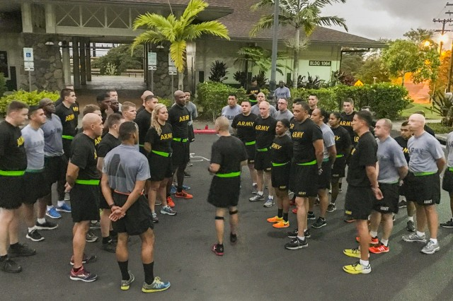 JOINT BASE PEARL HARBOR-HICKAM, Hawaii-Command Sgt. Maj. John W. Foley (center), the command sergeant major of the 94th Army Air and Missile Defense Command, U.S. Army Pacific, speaks to enlisted leaders, Feb. 15, 2017, about the importance of physical fitness and how it affects the Army mission following an early morning run on Radar Hill at Fort Shafter Hawaii. The run was the first formal event during Command Sgt. Maj. Foley's Leader Professional Development Week Feb. 13 to Feb. 16, 2017. (U.S. Army photo by Sgt. Kimberly K. Menzies, 94th AAMDC Public Affairs)