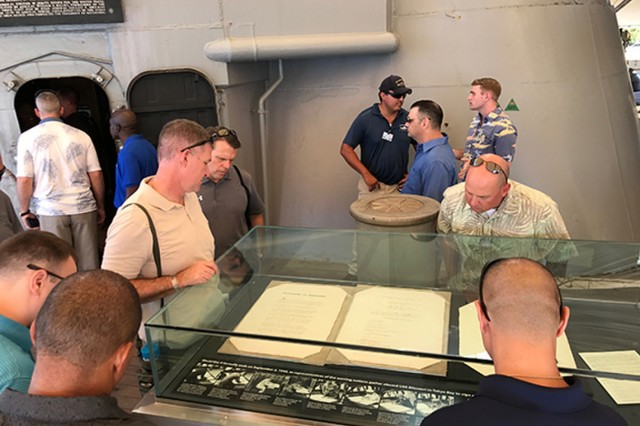 JOINT BASE PEARL HARBOR-HICKAM, Hawaii-Leaders with the 94th Army Air and Missile Defense Command, U.S. Army Pacific, examine, Feb. 16, 2017, a replica of the treaty that was signed aboard the USS Missouri at the end of World War II, during an official tour of the ship at Ford Island, Hawaii. The tour was the staff ride, an event during the formal portion of Command Sgt. Maj. Foley's Leader Professional Development Week Feb. 13 to Feb. 16, 2017. (U.S. Army photo by Sgt. Kimberly K. Menzies, 94th AAMDC Public Affairs)