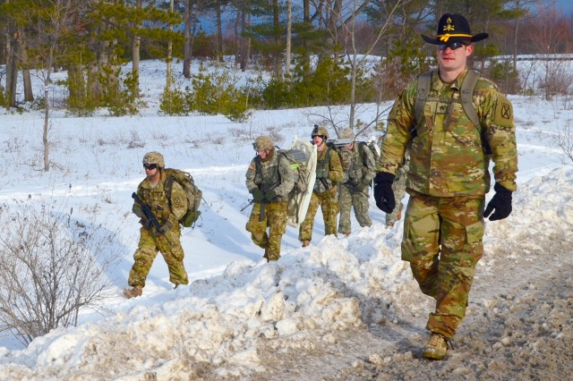 """Staff Sgt. Christopher Clingempeel, a scout with A Troop, 3rd Squadron, 71st Cavalry Regiment, 1st Brigade Combat Team, leads a team of """"spur candidates"""" to their next challenge during the Ghost Squadron Spur Ride on Feb. 15 at Fort Drum."""
