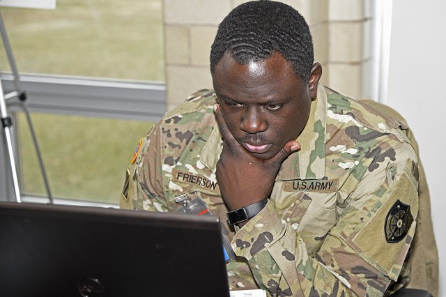 Chief Warrant Officer 3 Charles Frierson, a cyber planner with the 154th Cyber Protection Team, Fort Gordon, Ga., keeps a close eye on the network during a live cyber exercise at Muscatatuck Urban Training Center in Butlerville, Ind., Jan. 10.