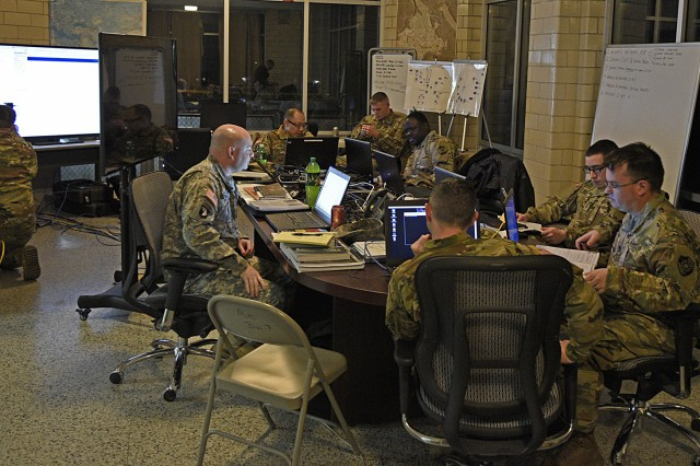 Soldiers and civilians with the 154th Cyber Protection Team, Fort Gordon, Ga., prepare for the early-morning start of a live cyber exercise at Muscatatuck Urban Training Center in Butlerville, Ind., on January 10th.