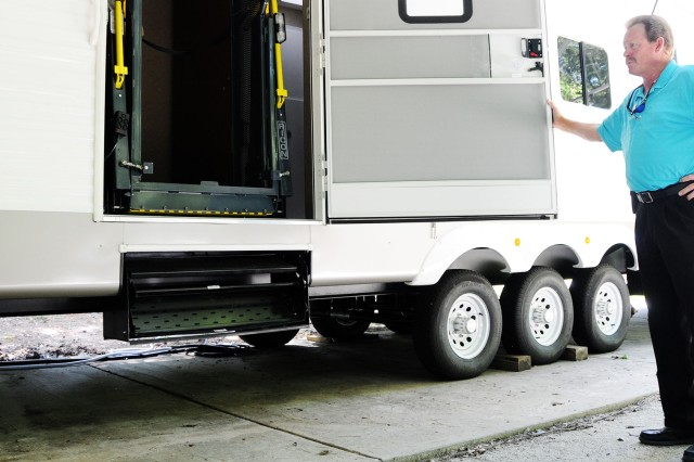 John Clancy, ODR manager, gives a view of the hydraulic wheelchair lift on the new wounded warrior trailer available to wounded warriors and disabled veterans at no cost.