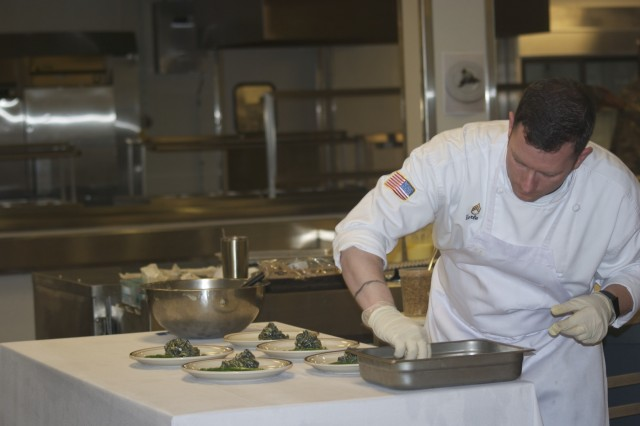 Staff Sgt. Gabriel J. Earle, the 3rd Infantry Division culinary arts team manager, pays attention to detail as he prepares a dish for 50 food critics at Fort Stewart, Ga., Feb. 16, 2017.  The 3rd Infantry Division culinary arts team competes annually in the Military Culinary Arts Competitive Training Event. (U.S. Army photo by Spc. Alex Seekings/ Released)