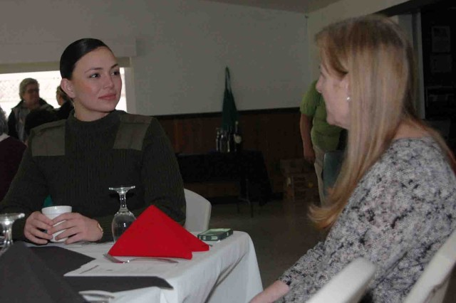 MARINA, California -- Pvt. Korryn Miller (left) of the U.S. Marine Corps Detachment, Presidio of Monterey, speaks to Cheryl Panek, a Navy veteran, at the American Legion Post 694's Women Veterans, Widows and Widower's luncheon Feb. 18.