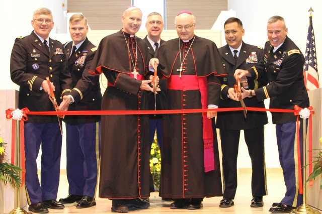 """On the 74th anniversary of the sinking of the Dorchester during World War II when the heroic actions of four Army chaplains are commemorated, U.S. Army Garrison Bavaria held a ribbon-cutting ceremony to dedicate the first chapel built for Soldiers in Europe in more than 17 years.The Netzaberg Chapel, built for the Grafenwoehr, Germany, military community will be a power projection platform for faith and resiliency, said Col. Lance Varney, USAG Bavaria commander, during his opening remarks Feb. 3.When Col. Matthew Tyler, commander of Europe District, U.S. Army Corps of Engineers, presents Varney with the ceremonial key for the, he said, """"As a Soldier, I recognize the importance of maintaining spiritual health and focus. It's part of our readiness and resilience. It's critical to the well-being of our personnel and community."""""""