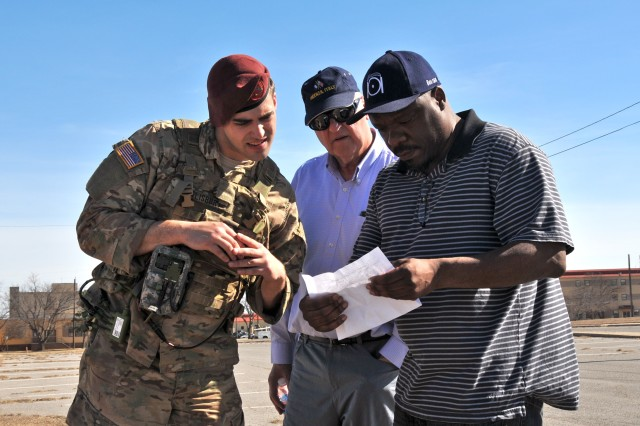 (From left) Spc. Garrett Salisbury, Neil Vestermark and Markes Jackson discuss the Precision Fires-Dismounted system, a software application hosted on the Nett Warrior End User Device, Feb. 6 at Fort Sill, Oklahoma.