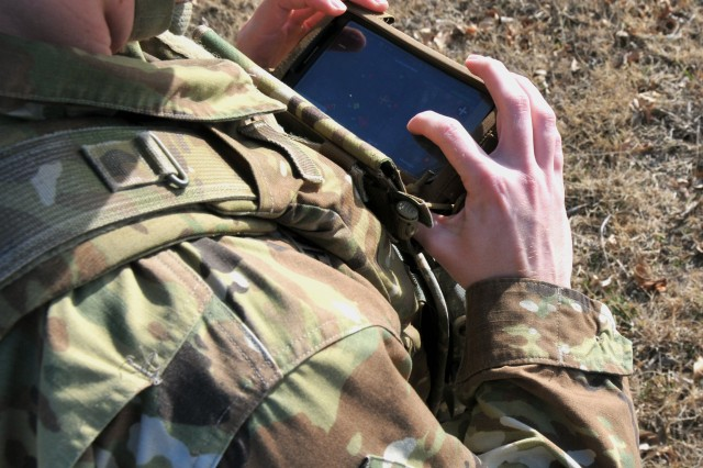 Sgt. Nathaniel Shaver trains on the Precision Fires-Dismounted system, a software application hosted on the Nett Warrior End User Device, Feb. 7 at Fort Sill, Oklahoma.