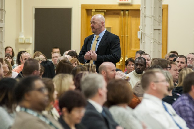Jay Carr, executive director, U.S. Army Contracting Command-Rock Island, speaks to more than 300 employees during an Employee Engagement Event in Heritage Hall, Rock Island Arsenal, Illinois, Feb. 23.