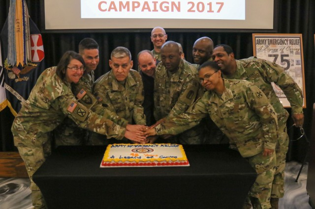 Eighth Army Senior Enlisted Advisor, Command Sgt. Maj. Richard E. Merritt leads eighth army soldiers in cutting a cake signifying the start of the 2017 Army emergency relief campaign March 1. AER provides financial assistance to service members and their families in the event of an emergency.