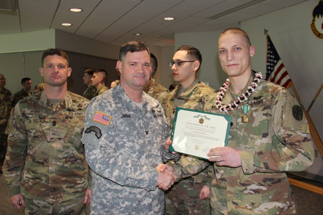 Spc. Lyndon Wright (right) receives an Army Commendation Medal from Medical Department Activity -- Alaska commander, Col. Christopher Jarvis and Command Sgt. Major Uriah Popp for being selected as the MEDDAC-AK Best Warrior in the junior enlisted category March 3 at Bassett Army Community Hospital. Wright, a nutrition care specialist at Bassett ACH, will represent MEDDAC-AK at the Regional Health Command -- Pacific Best Warrior Competition in May.