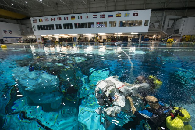 Retired Col. Mark Vande Hei conducts training inside NASA's Neutral Buoyancy Laboratory pool near Johnson Space Center in Houston March 1, 2017. The pool is one of the world's largest at 202 feet long and 40 feet deep, and is big enough to hold a replica of the International Space Station. Wearing a specialized spacesuit that recreates microgravity, Vande Hei floated around the mock station to practice upgrading large nickel hydrogen batteries with lithium ion ones, a task he may have to do as part of a spacewalk.