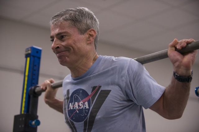 Retired Col. Mark Vande Hei trains on the advanced resistive exercise device, which astronauts use to stop muscle loss while being weightless in space. Astronauts can simulate free-weight exercises in normal gravity by using the device's adjustable resistance piston-driven vacuum cylinders to get a load of up to 600 pounds. Vande Hei is preparing for his first space mission, which is currently scheduled for mid-September.