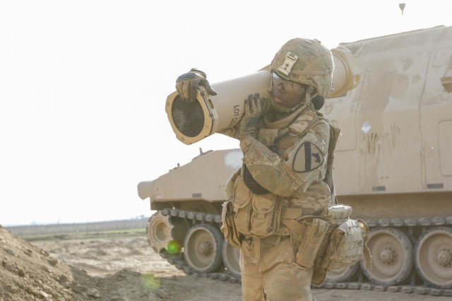 U.S. Army Pfc. Shymeka D. Parker, a cannon crewmember assigned to C Battery, 2nd Battalion, 82nd Field Artillery Regiment, 3rd Armored Brigade Combat Team, 1st Cavalry Division, carries artillery charges from an M992 Field Artillery Ammunition Supply Vehicle at a tactical assembly area at Hamam al-Alil, Iraq, Feb. 27, 2017. A global Coalition of more than 60 regional and international nations has joined together to enable partner forces to defeat ISIS and restore stability and security. Combined Joint Task Force-Operation Inherent Resolve is the global Coalition to defeat ISIS in Iraq and Syria.