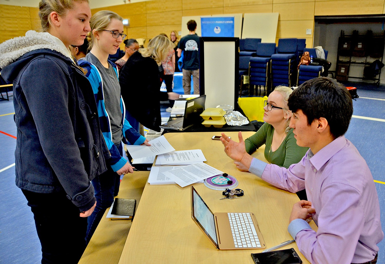 students explore options at youth job and volunteer expo article get information about the school s career practicum program from student interns aaron brown and darrin waterbury at the youth job and volunteer expo