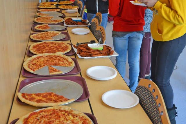 Students enjoy pizza and other goodies at the After Party in the Wiesbaden Entertainment Center following the Youth Job and Volunteer Expo.