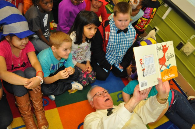 "Looking up from the mat on the floor, Ed Worley could not only see the words to ""Fox in Socks"" but he could also see the tiny faces of twenty first-graders surrounding him. Whether they were more entertained by the book or the fact that he was on their level, one thing was certain: he had their attention.On March 2, Dr. Seuss's birthday, nineteen Army Contracting Command employees read at Morris Elementary, which is its local adopted school, as part of Read Across America Week. This is the most volunteers that ACC has had in the four years that it has participated in this program."