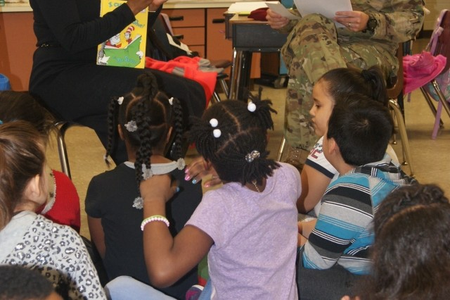 (Left to right) 80th Training Command soldiers Ms. Clarissa Taylor and Maj. Scott Randall read to children during their visit at Hopkins Elementary School in Chesterfield, Va., on March 2, 2017, in honor of Dr. Seuss' birthday and Read Across America Day.