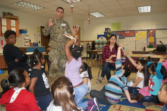 (Left to right) 80th Training Command soldiers Ms. Clarissa Taylor and Maj. Scott Randall ask children what they want to be when they grow up, as their teacher Mrs. Melinda Dart (sitting) listens. Taylor and Randall volunteered to read and visit with the children at Hopkins Elementary School in Chesterfield, Va., on March 2, 2017, in honor of Dr. Seuss' birthday and Read Across America Day