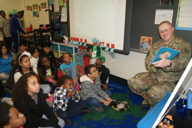 "80th Training Command soldier Sgt. 1st Class Shawn Brady reads ""When Charlie McButton Lost Power"" to fifth graders at Hopkins Elementary School in Chesterfield, Va., on March 2, 2017, in honor of Dr. Seuss' birthday and Read Across America Day."