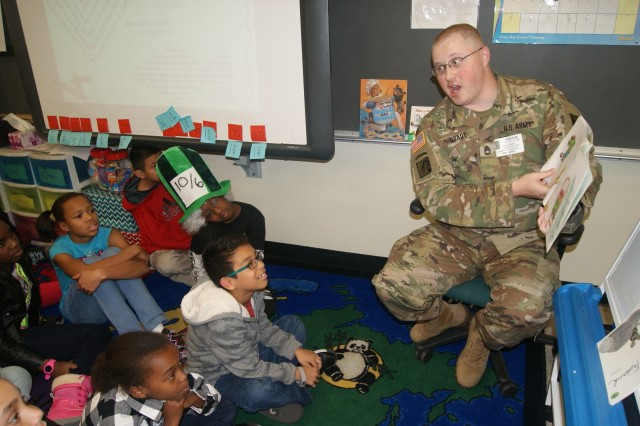 "80th Training Command soldier Sgt. 1st Class Shawn Brady reads a silly story, ""When Charlie McButton Lost Power,"" to fifth graders at Hopkins Elementary School in Chesterfield, Va., on March 2, 2017, in celebration of Dr. Seuss' birthday and Read Across America Day."