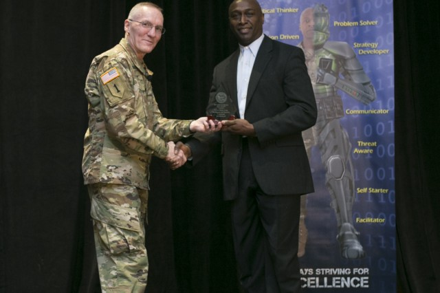 Floyd Edwards, U.S. Army Intelligence and Security Command (INSCOM), office of the assistant chief of staff, G-3, receives the runner-up award for the Best Protection Program during the Annual Worldwide Army Antiterrorism Conference, from Maj. Gen. A. Ray Royalty, director, Department of the Army G-34, Feb. 1, 2017. (U.S. Army Photo)