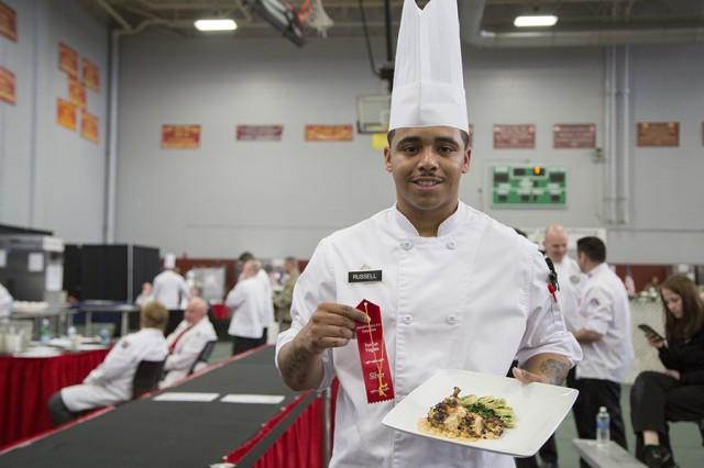 Culinary Specialist PV2 Javon Russell, with the 11th ACR RSS, Fort Irwin, Calif., holds the dish that won him a silver medal during the 42nd Annual Military Culinary Arts Competition and Training Event, held at Fort Lee, Virginia. The annual MCACTE is the largest American Culinary Federation sanctioned competition in North America which showcases the talents of military chefs from all services and foreign military teams. (Photo by Visual Information Specialist Stefanie Antosh)