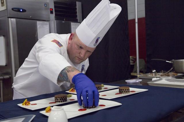Culinary Specialist Sergeant 1st Class Michael Bogle, an enlisted aide with 10th Mountain Division, at Fort Drum, New York, prepares his cold plate dessert during the 42nd Annual Military Culinary Arts Competition and Training Event, held at Fort Lee, Virginia. The annual MCACTE is the largest American Culinary Federation sanctioned competition in North America which showcases the talents of military chefs from all services and foreign military teams. (Photo by Visual Information Specialist Stefanie Antosh)