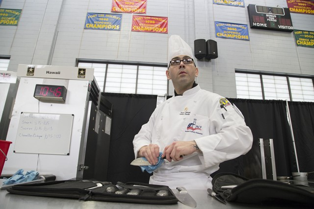 Culinary Specialist Staff Sergeant Fabian Murrillo, with Team Hawaii, wipes down a knife as he prepares to compete in the 42nd Annual Military Culinary Arts Competition and Training Event, held at Fort Lee, Virginia. The annual MCACTE is the largest American Culinary Federation sanctioned competition in North America which showcases the talents of military chefs from all services and foreign military teams. (Photo by Visual Information Specialist Stefanie Antosh)