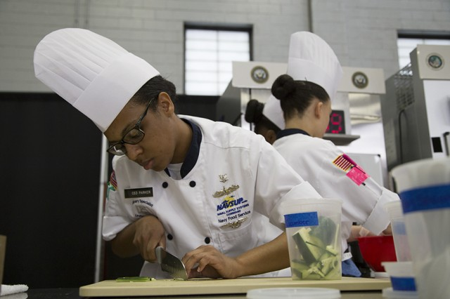Navy Culinary Specialist  Petty Officer 3rd Class Bianca Parker, with Naval Supply Systems Command, Norfolk, Virginia, slices cucumber during the 42nd Annual Military Culinary Arts Competition and Training Event, held at Fort Lee, Virginia. The annual MCACTE is the largest American Culinary Federation sanctioned competition in North America which showcases the talents of military chefs from all services and foreign military teams. (Photo by Visual Information Specialist Stefanie Antosh)
