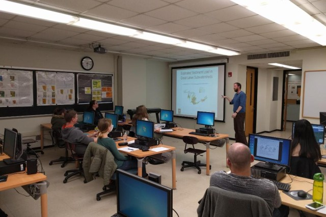 Michael Voorhees delivers a lecture about sediment transport modeling to a class at Buffalo State College.