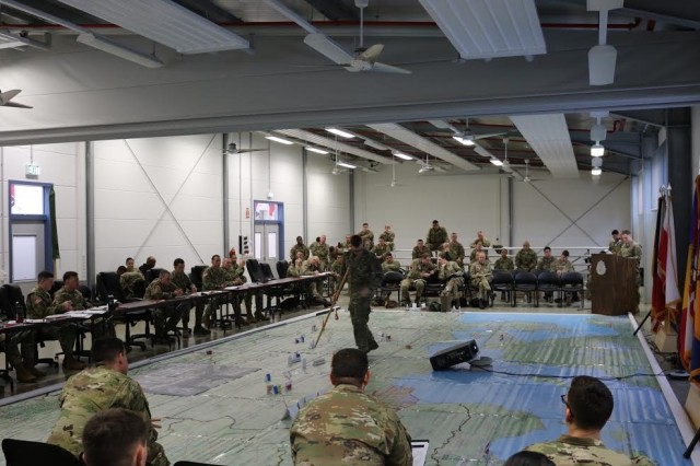A map of the tactical road march from Rose Barracks to Poland is a superb visual guide for the audience, allowing them to envision each convoy as a speaker explains the route, including sustainment locations and possible obstacles throughout the way, Feb. 24, 2017 on Rose Barracks, Germany. The rehearsal of concept is one of the final steps to prepare for 2nd Squadron's deployment to Poland in support of enhanced Forward Presence.