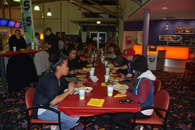 Members of the garrison's BOSS program enjoy Thanksgiving dinner at the Galaxy Bowling Center, Panzer Kaserne, 2016.