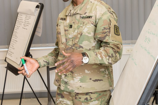 LANDSTUHL, Germany - Capt. John O. Okomu, social worker, 254th Medical Detachment, Combat Operational Stress Control, compiles a unit assessment from his group at training by the U.S. Army Medical Department Center and School Combat and Operational Stress Control Mobile Training Team on Mar. 2, 2017. (U.S. Army photo by Capt. Jerome Ferrin, 30th Medical Brigade Public Affairs)
