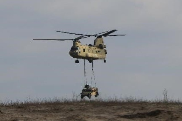 FORT POLK, Louisiana -- A CH-47 Chinook assigned to 2nd Battalion, 25th Aviation Brigade, 25th Infantry Division, sling-loads a HMMWV above Geronimo Drop Zone, Feb. 12, 2017, during rotation 17-04 at the Joint Readiness Training Center in Fort Polk, Louisiana. (Photo courtesy of Joint Readiness Training Center, Operations Group, Public Affairs Office/Released)