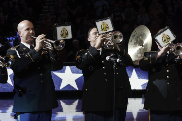 Members of the brass section with the 56th Army Band, perform the national anthem on Veterans Day Nov. 11, 2016, in Portland, Ore. (U.S. Army photo by Sgt. Youtoy Martin, 5th Mobile Public Affairs Detachment)