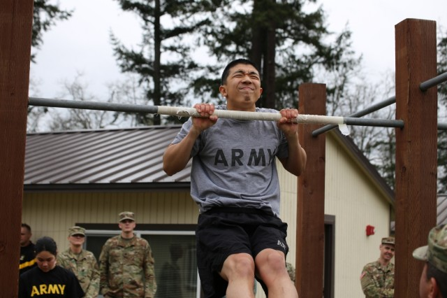 Washington National Guard soldier Cadet Kevin Jiang, Alpha Company 1st Battalion, 161st Infantry Regiment, performs the pull-up during the Best Warrior competition, March 3, 2017, Joint Base Lewis-McChord, Wash. The competitors had to perform as many pull-ups as possible without coming down from the bar.