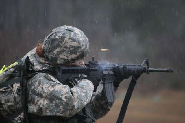 Washington National Guard soldier Spc. Stephanie Smith, Headquarters and Headquarters Company, 303rd Cavalry Regiment, fires her M4 on a range during the best warrior competition, March 3, 2017, Joint Base Lewis-McChord, Wash. During several of the lanes, soldiers performed rigorous activities to test their stamina and create a more challenging environment.
