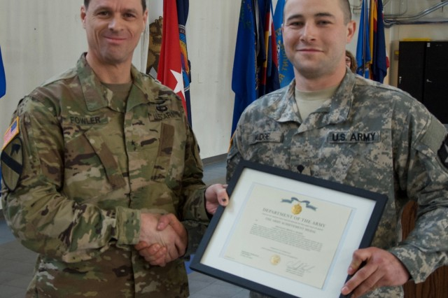BG Christopher Fowler, Land Component Commander, Washington Army National Guard, awards the Army Achievement Medal to Spc. Brock Mudge, an infantryman assigned to C Co., 3rd Battalion, 161st Infantry Regiment for winning Best Soldier in the 2017 Washington Army National Guard Best Warrior competition. Best Warrior is a four-day competition designed to test the candidates physical endurance, military knowledge and basic soldiering skills.