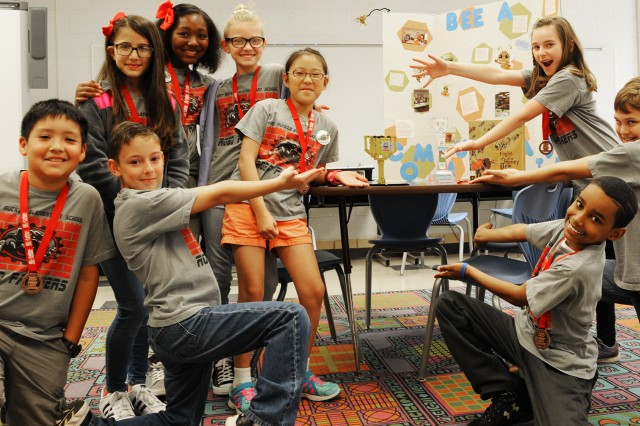 Team members of the Fort Rucker Elementary School robotics team, Robo Panthers, pose with their trophies during a meeting of the robotics club March 7.