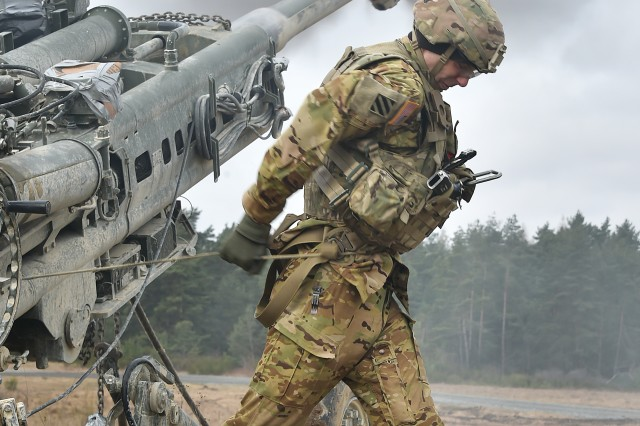 U.S. Army Spc. Vincent Ventarola, assigned to Cobra Battery, Field Artillery Squadron, 2nd Cavalry Regiment, pulls the lanyard on a M777 Howitzer during Exercise Dynamic Front II at the 7th Army Training Command's Grafenwoehr Training Area, Germany, March 9, 2017. (U.S. Army photo by Visual Information Specialist Gertrud Zach)