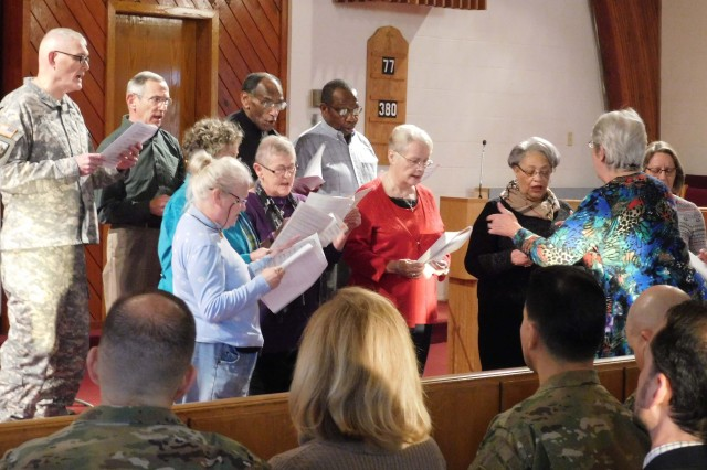 "THE MAIN POST CHAPEL CHOIR, UNDER THE DIRECTION OF DEE CORKRAN, PERFORMED ""Gonna Set This World on Fire"" during the National Prayer Breakfast held March 2 at Prichard Chapel on Fort Knox."