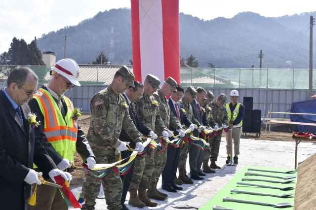 Military and Korean guests cut the ribbon during the groundbreaking ceremony for the Camp Walker Tower 2 on Feb. 27