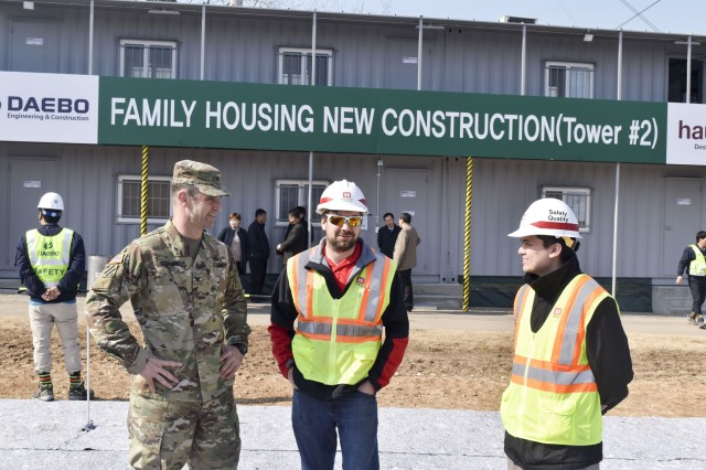 USAG Daegu Commader, Col. Ted Stephens talks with employees from the U.S. Army Corps of Engineers, Far East District at the Camp Walker construction site on Feb. 27.
