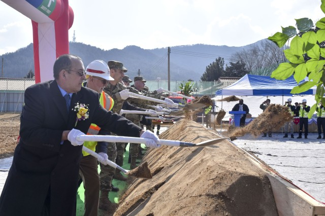 USAG Daegu Housing Director Wilfredo Moore, Military and Korean guests shovel a first dirt during the Camp Walker Tower 2 groundbreaking ceremony on Feb. 27.