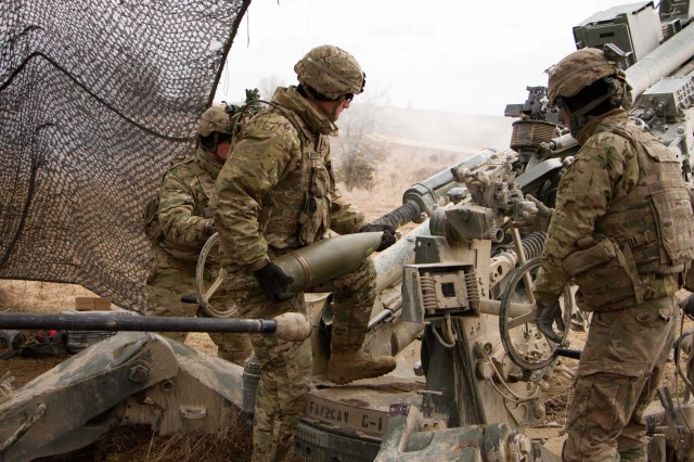Sgt. Johnnie Morton, round runner for the gun crew of 1st Section, 1st Platoon, Cobra Battery, Field Artillery Squadron, 2d Cavalry Regiment, U.S. Army, loads a 155mm artillery round onto a M777A2 Howitzer during a fire mission March 8, 2017 in the Grafenwoehr Training Area, Germany. The Squadron participated in Dynamic Front II March 6-9, 2017. The exercise enabled the U.S., Germany and Czech Republic together to synchronize their artillery capabilities.