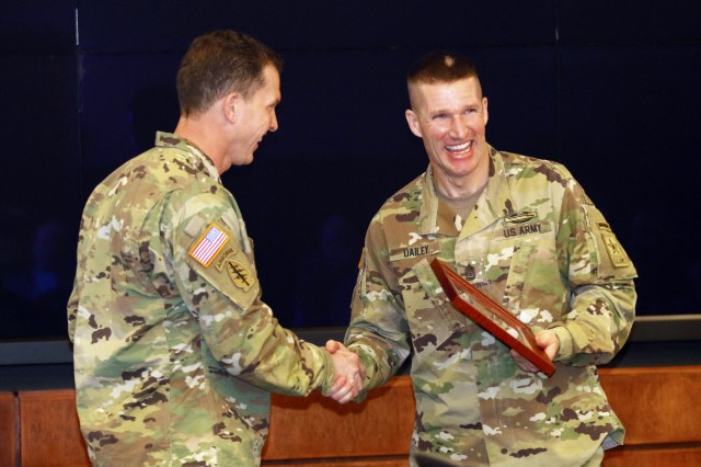 Sgt. Maj. of the Army Daniel Dailey is presented with a group photo taken with all the sergeants major in attendance at the U.S. Army Special Operations Command sergeant major conference and slating board, as a token of appreciation for his participation, during the USASOC CSM conference and slating board, Feb. 2, 2017, at MacDill Air Force Base, Tampa Florida. The USASOC CSM conference and slating is an opportunity for sergeants major from across the USASOC enterprise to interact, network and discuss current strategic plans as well as the way forward at the individual unit level. (U.S. Army photo by Sgt. Kyle Fisch/Released)